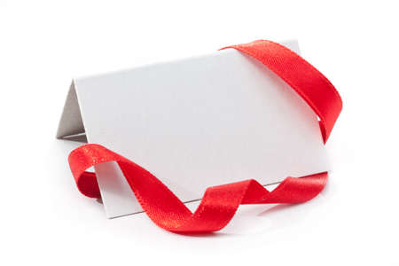 Gift tag on white background with red ribbon. best for sale. copy space for text photo