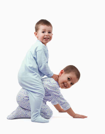 Two young boys playing around and laughing from joy; isolated on white Stock Photo - 8929277