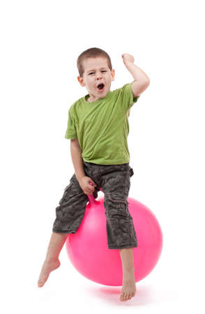 ball stretching: Boy jumping on a large ball