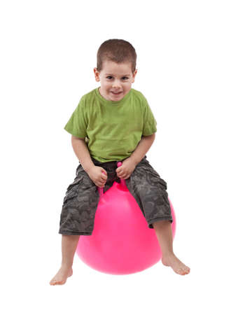 Boy jumping on a large ball  Stock Photo - 8929300