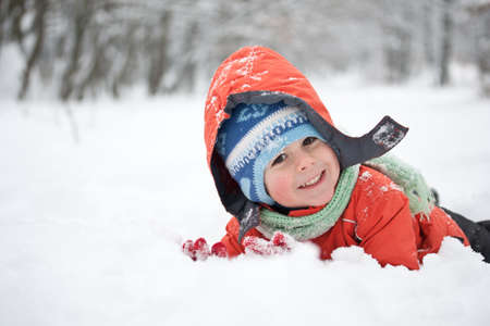 winter jacket: Little boy having fun in the snow Stock Photo