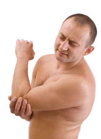 Young man with an expression of severe pain in his elbow  . White background. Stock Photo - 8929346