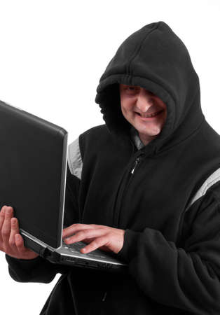 Closeup portrait of a young male thief stealing data from laptop computer  Stock Photo - 8929365