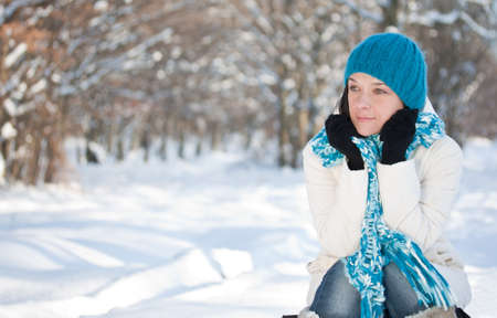 Woman keeping warm outside in the snow  photo