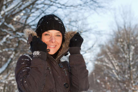 Pretty young woman in winter forest.  photo