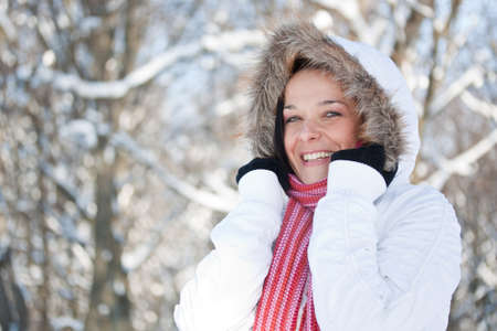 furred: Beautiful happy woman in snowy winter outdoors  Stock Photo