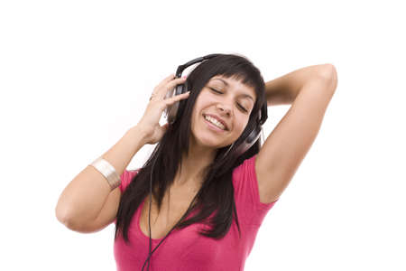 Happy woman with headphones, listen to music and dancing Stock Photo - 9024263