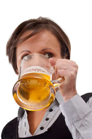 Woman drinking beer from the glass photo