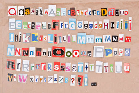 sorted: Alphabet, letters sorted on paper background Stock Photo
