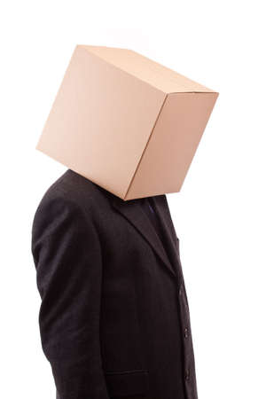 Businessman with a brown box on his head Stock Photo