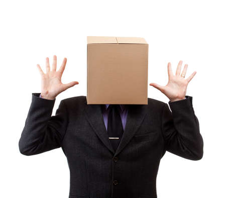 Businessman with a brown box on his head, in white photo