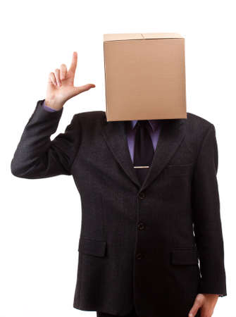 Businessman with a brown box on his head, concept, isolated in white photo