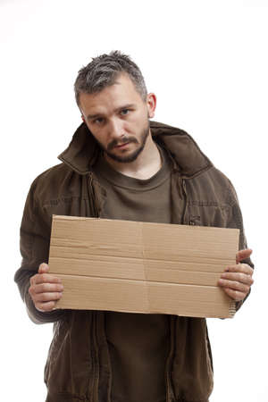 A beggar holding carton suitable for adding text, isolated on white background Stock Photo - 9024672