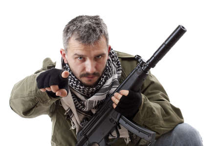 paramilitary: Terrorist with rifle pointing his finger for you, isolated on white background