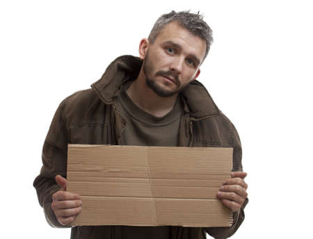 homeless man: A beggar holding carton suitable for adding text, isolated on white background