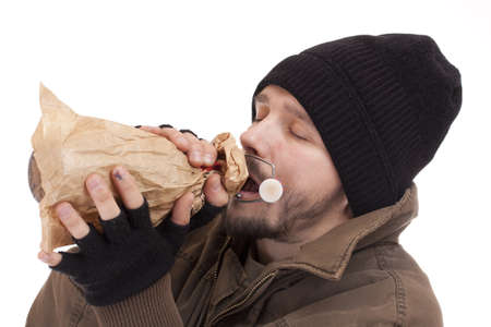 Homeless man holding a bottle of alcohol Stock Photo - 9024819