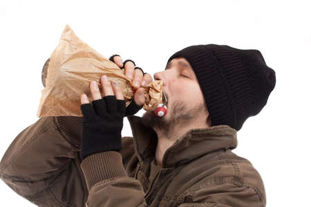 Homeless man holding a bottle of alcohol photo