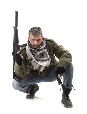 Terrorist with gun, isolated on white background photo