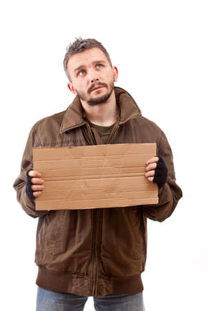 Beggar holding carton suitable for adding text, isolated on white background Stock Photo - 9024669