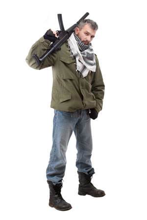 Terrorist with rifle, isolated on white background photo