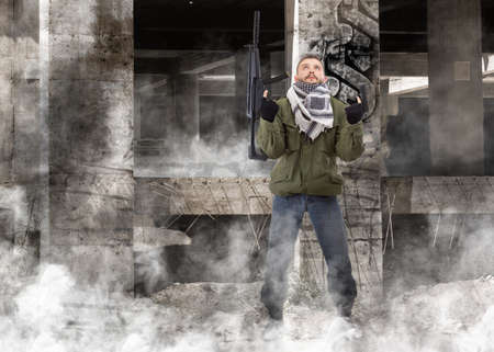 Terrorist with rifle, grunge buildings in background photo