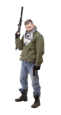 Terrorist with weapon and gun, isolated on white background photo
