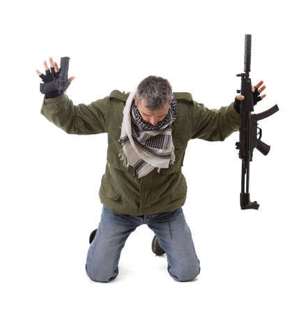 Terrorist with hands up, isolated in white photo
