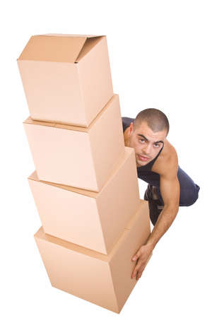 Man struggling while lifting lots of cardboard boxes - moving concept  photo