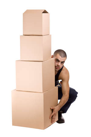 Man struggling while lifting lots of cardboard boxes - moving concept Stock Photo - 9024564