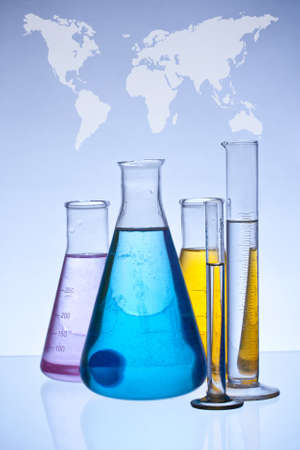 matrass: chemical laboratory glassware equipment with color liquid and globe map Stock Photo