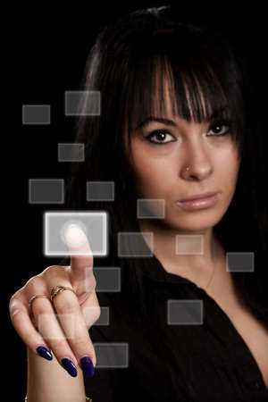 woman hand pressing digital buttons in black backgound Stock Photo - 9185466