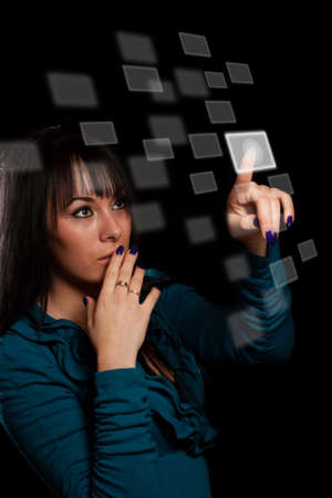 black backgound: woman hand pressing digital buttons in black backgound Stock Photo