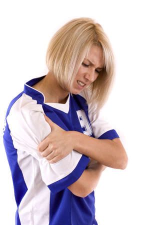 chest pain: female handball player holding on arm, isolated in white Stock Photo