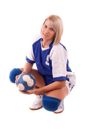Female handball player posing, isolated in white photo