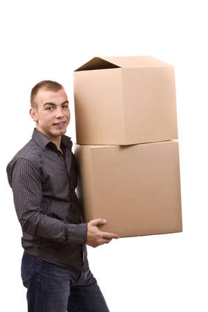 Man lifting lots of cardboard boxes - moving concept Stock Photo