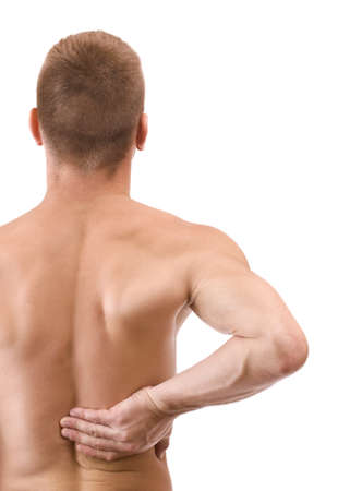 aching muscles: Young man with back pain, isolated in white