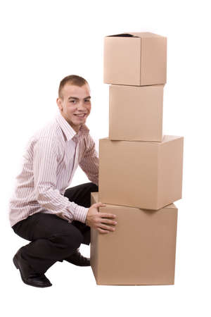 Man lifting lots of cardboard boxes - moving concept  photo