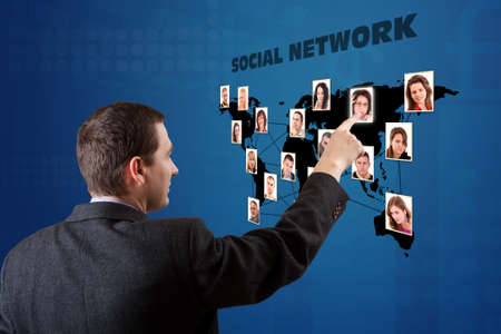 business man pressing a social network map photo