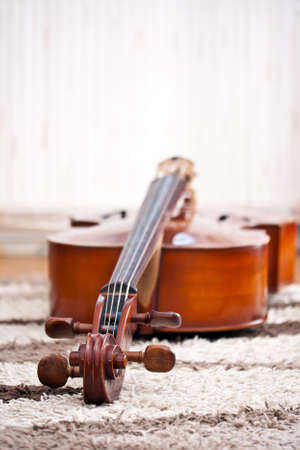 Detail of a classical cello in white background photo