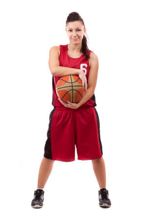 a basketball player: Smiling female basketball player with ball, isolated on white background