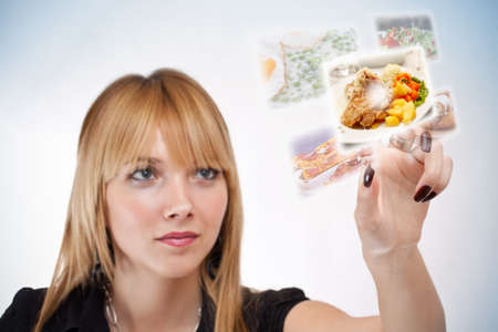 reality: woman pressing a touchscreen button, with food selection