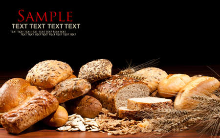 Assortment of baked goods in black background Stock Photo - 10182188