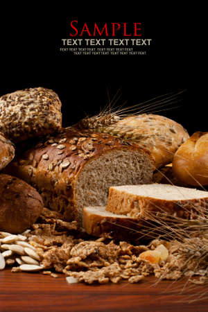 bread slice: Assortment of baked goods in black background Stock Photo