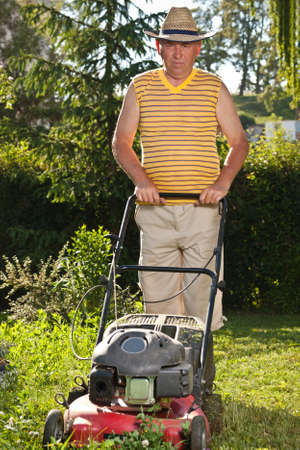 Senior man mowing the lawn Stock Photo - 10182203