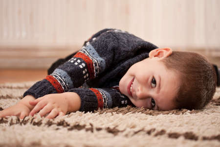 a happy smiling boy playing and having fun at home  photo