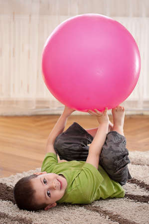 exhilarated: Boy play with large ball in room