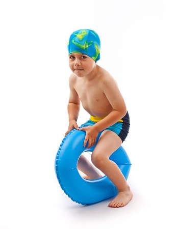 swimming pool float: Funny little boy playing with blue life ring in swim caps, isolated in white
