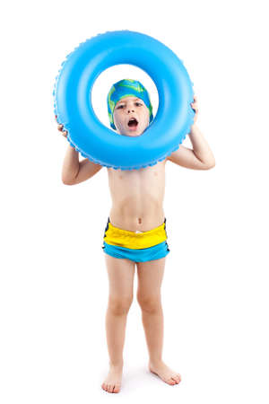 child swimsuit: Funny little boy playing with blue life ring in swim caps, isolated in white