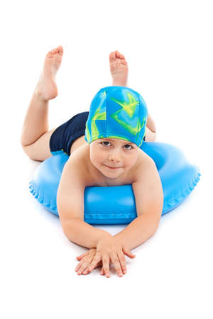 preteens beach: Funny little boy playing with blue life ring in swim caps, isolated in white