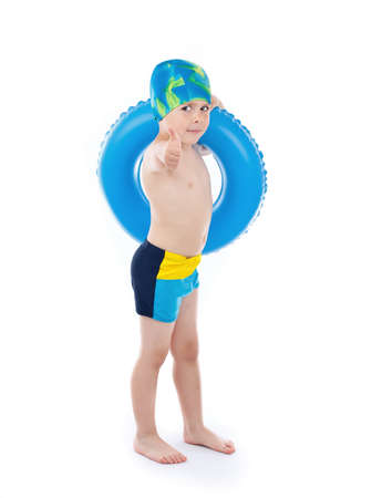float: Funny little boy playing with blue life ring in swim caps, isolated in white